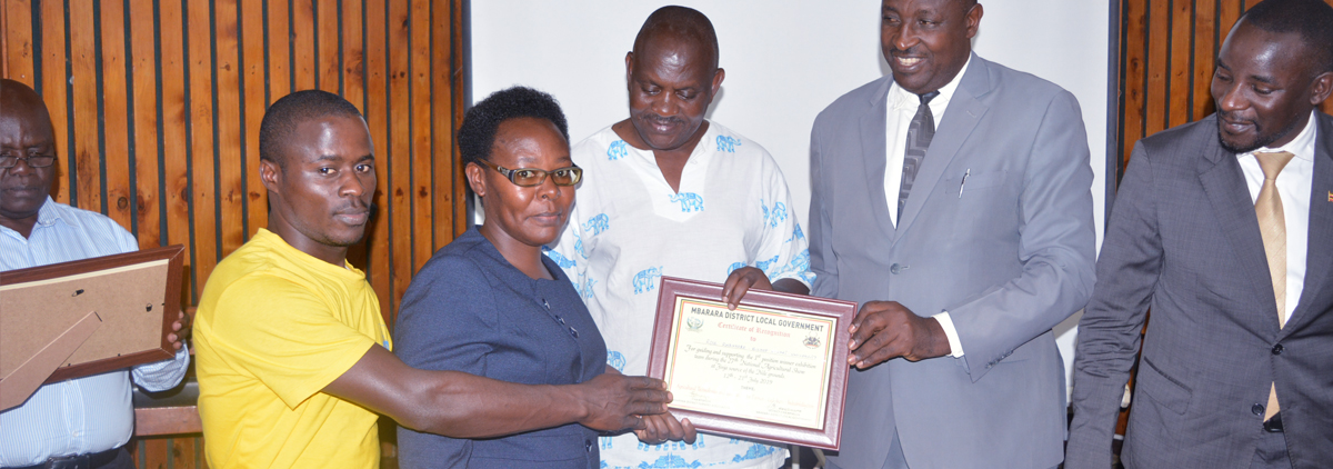 Mbarara District Farmers' Association (MBADIFA) recognises Bishop Stuart University for the efforts that enabled them to become overall winners during last year's  27th National Farmers Agricultural Show