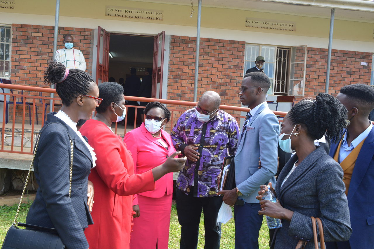 Prof. Maud Kamatenesi Mugisha-VC, Head of Department of Law Ms Hawa Ruhweza, BSU Law society president HE Asiimwe Ronald Williams share a word with Hon. Justice Catherine and acting IGG George Nathan Bamugemereire after the symposium